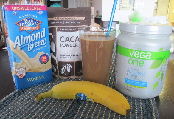 To make the smoothie - 1 1/2 cups unsweetened vanilla almond milk, 2 tablespoons raw cacao powder, 1 scoop French vanilla Vega One, 1 banana. Blend with a handful of ice until smooth.